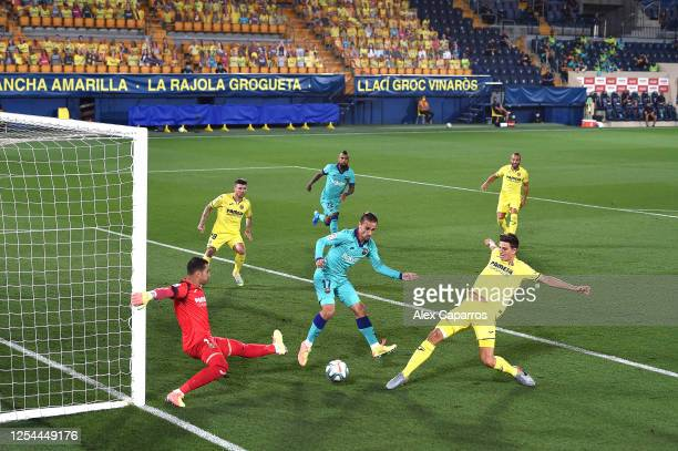 Pau Francisco of Villarreal scores an own goal under pressure from Antoine Griezmann of Barcelona during the Liga match between Villarreal CF and FC...