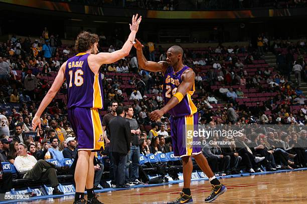 Pau Gasol and Kobe Bryant of the Los Angeles Lakers celebrate their win against the New Jersey Nets after the game on March 27 2009 at the Izod...