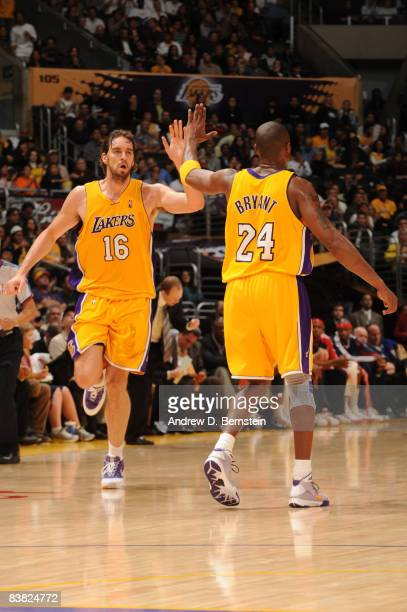 Pau Gasol and Kobe Bryant of the Los Angeles Lakers slap hands during their game against the New Jersey Nets at Staples Center November 25 2008 in...