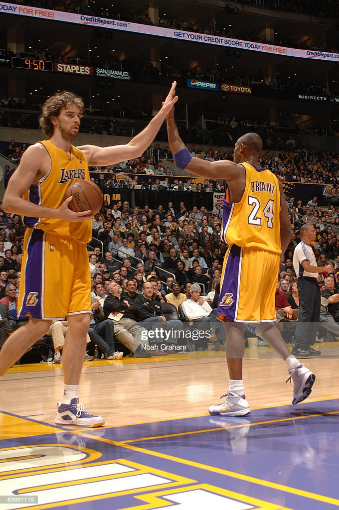 Pau Gasol #16 and Kobe Bryant #24 of the Los Angeles Lakers slap hands during their game against the Phoenix Suns at Staples Center on December 10, 2008 in Los Angeles, California.
