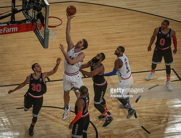 Pau Gasol and Kyrie Irving of Eastern Conference AllStar Team in action against Chris Paul Stephen Curry of Western Conference AllStar Team during...