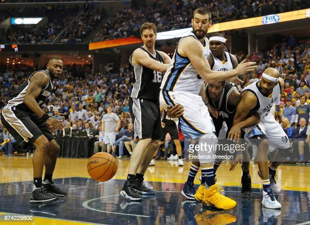 Pau Gasol and LaMarcus Aldridge of the San Antonio Spurs fight against Marc Gasol and Vince Carter for a loose ball during the second half of a 10396...
