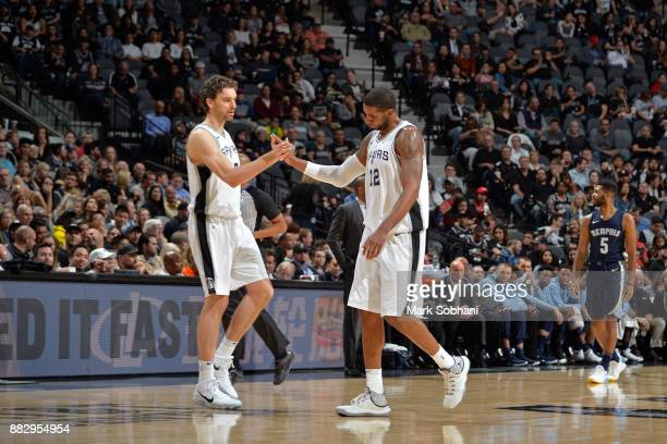 Pau Gasol and LaMarcus Aldridge of the San Antonio Spurs shake hands during the game against the Memphis Grizzlies on November 29 2017 at the ATT...