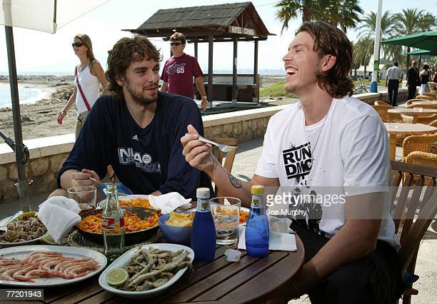 Pau Gasol and Mike Miller of the Memphis Grizzlies share have lunch during an NBA Entertainment shoot during EA Sports NBA Europe Live Tour October...
