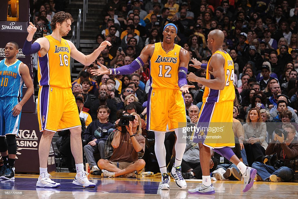 Pau Gasol #16, Dwight Howard #12 and Kobe Bryant #24 of the Los Angeles Lakers congradulate each other during the game against the New Orleans Hornets at Staples Center on January 29, 2013 in Los Angeles, California.