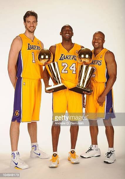 Pau Gasol Kobe Bryant and Derek Fisher of the Los Angeles Lakers pose with the Larry O'Brien Trophy during NBA Media Day at Toyota Sports Center on...