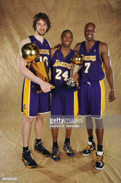 Pau Gasol Kobe Bryant and Lamar Odom of the Los Angeles Lakers pose for a portrait after defeating the Orlando Magic in Game Five of the 2009 NBA...