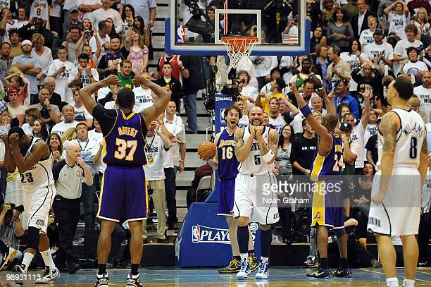 Pau Gasol Kobe Bryant and Ron Artest of the Los Angeles Lakers celebrate their win against Carlos Boozer and Deron Williams of the Utah Jazz in Game...
