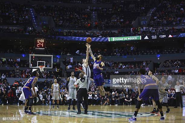 Pau Gasol of San Antonio Spurs jumps for the ball with Tyson Chandler of Phoenix Suns during the match between San Antonio Spurs and Phoenix Suns at...