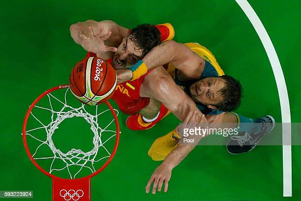 Pau Gasol of Spain and David Andersen of Australia compete for the ball during the Men's Basketball Bronze medal game between Australia and Spain on...