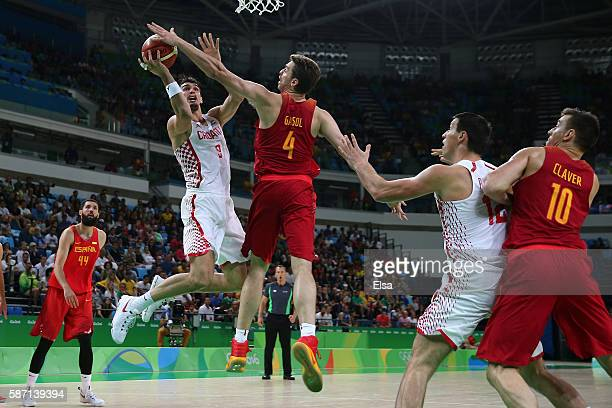 Pau Gasol of Spain blocks a shot by Dario Saric of Croatia during a Men's preliminary round basketball game between Croatia and Spain on Day 2 of the...