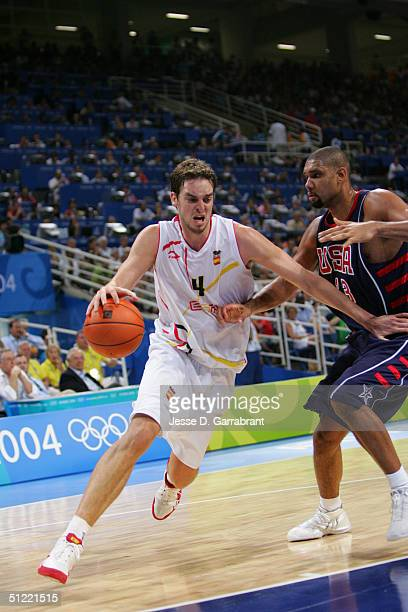 Pau Gasol of Spain drives against Tim Duncan of the USA during the mens' basketball quarterfinal game on August 26 2004 during the Athens 2004 Summer...