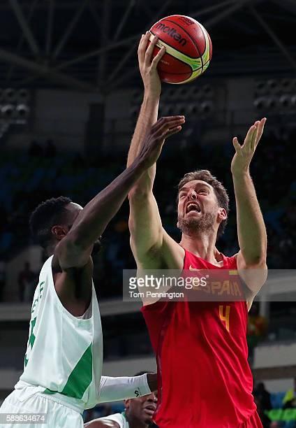 Pau Gasol of Spain drives to the basket against Ekene Ibekwe of Nigeria during the Men's Basketball - Preliminary Round Group B Nigeria vs Spain on...