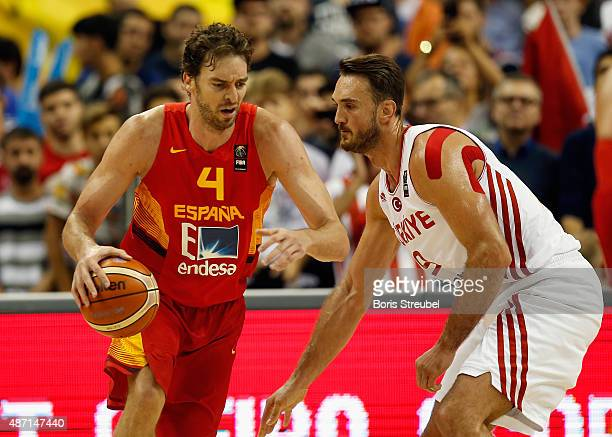 Pau Gasol of Spain drives to the basket against Semih Erden of Turkey during the FIBA EuroBasket 2015 Group B basketball match between Turkey and...