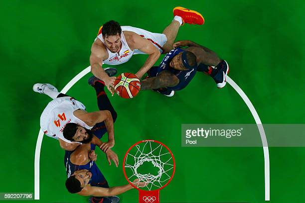 Pau Gasol of Spain goes to the basket against Demarcus Cousins and Klay Thompson of United States as Nikola Mirotic of Spain looks on during the...