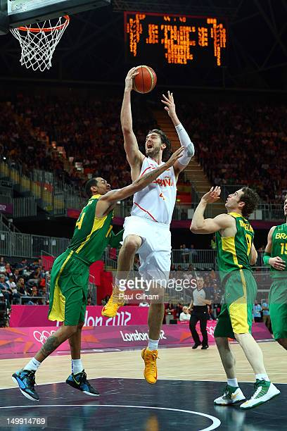 Pau Gasol of Spain goes to the hoop against Marquinhos Vieira Sousa of Brazil during the Men's Basketball Preliminary Round match on Day 10 of the...