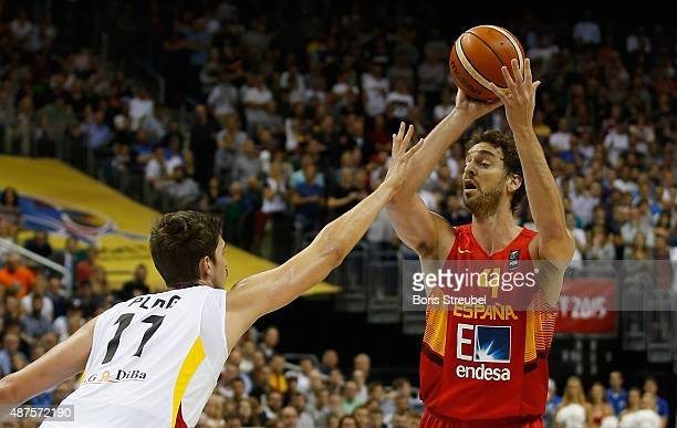 Pau Gasol of Spain looks to pass against Tibor Pleiss of Germany during the FIBA EuroBasket 2015 Group B basketball match between Germany and Spain...
