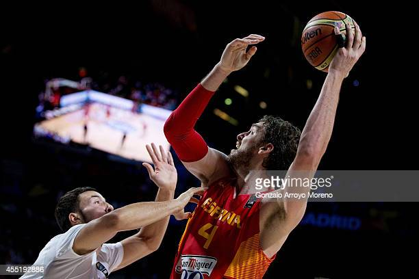Pau Gasol of Spain shoots against Joffrey Lauvergne of France during the 2014 FIBA World Basketball Championship quarter final match between France...