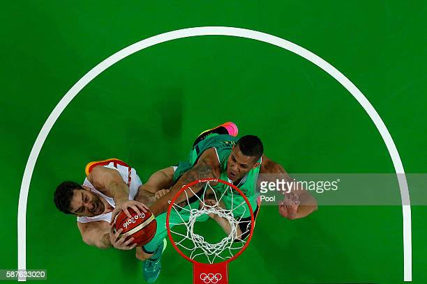 Pau Gasol of Spain shoots against Rafael Hettsheimeir of Brazil during a preliminary round basketball game between Spain and Brazil on Day 4 of the...