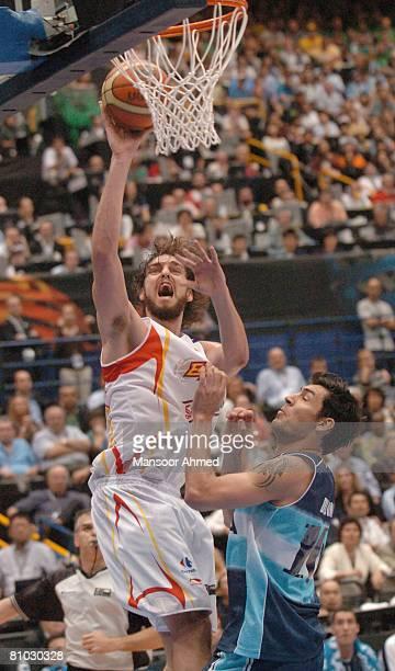 Pau Gasol of Spain shoots the tough jumper over Pablo Prigioni of Argentina during the FIBA World Championship 2006 Semi Final at the Saitama Super...
