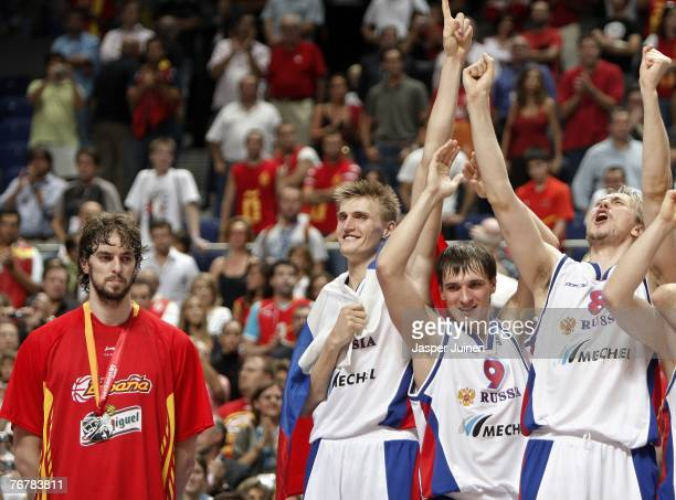 Pau Gasol of Spain stands dejected as Andrei Kirilenko celebrates with his teammates Petr Samoylenko and Nikita Morgunov after defeating Spain during...