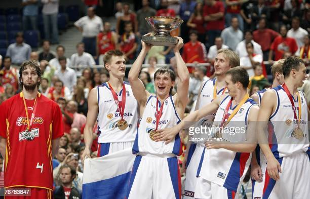 Pau Gasol of Spain stands dejected as Petr Samoylenko holds up the trophy celebrating amid his teammates after beating Spain during the FIBA...