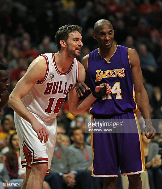 Pau Gasol of the Chicago Bulls and Kobe Bryant of the Los Angeles Lakers smile and chat as they await a free-throw at the United Center on February...