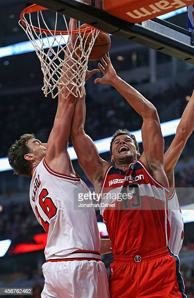 Pau Gasol of the Chicago Bulls blocks a shot by Kris Humphries of the Washington Wizards during a preseason game at the United Center on October 6...