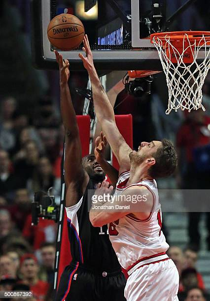 Pau Gasol of the Chicago Bulls blocks a shot by Luc Richard Mbah a Moute of the Los Angeles Clippers at the United Center on December 10 2015 in...