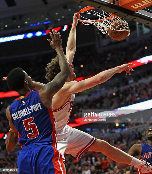 Pau Gasol of the Chicago Bulls dunks the ball with seconds to go over Kentavious CaldwellPope of the Detroit Pistons on his way to a gamehigh 26...