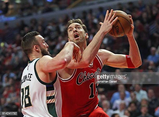 Pau Gasol of the Chicago Bulls goes up for a shot against Miles Plumlee of the Milwaukee Bucks on his way to a triple-double at the United Center on...