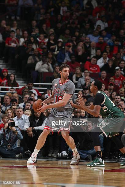 Pau Gasol of the Chicago Bulls handles the ball against John Henson of the Milwaukee Bucks on January 5 2016 at the United Center in Chicago Illinois...