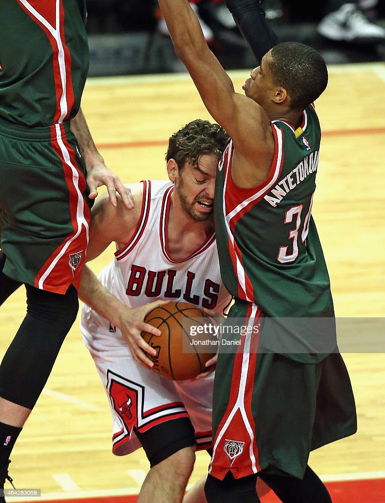 Pau Gasol #16 of the Chicago Bulls is squeezed by Miles Plumlee #21 and Giannis Antetokounmpo #34 of the Milwaukee Bucks at the United Center on February 23, 2015 in Chicago, Illinois.