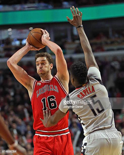 Pau Gasol of the Chicago Bulls looks to pass against Clint Capela of the Houston Rockets at the United Center on March 5 2016 in Chicago Illinois The...