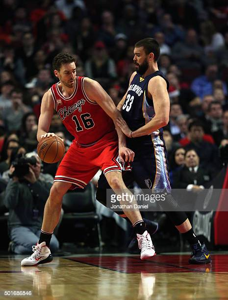 Pau Gasol of the Chicago Bulls moves against his brother Marc Gasol of the Memphis Grizzlies at the United Center on December 16 2015 in Chicago...
