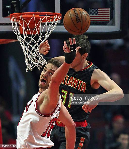 Pau Gasol of the Chicago Bulls reaches for a rebound in front of Mike Muscala of the Atlanta Hawks at the United Center on February 10 2016 in...