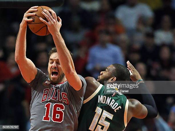 Pau Gasol of the Chicago Bulls rebounds over Greg Monroe of the Milwaukee Bucks at the United Center on January 5 2016 in Chicago Illinois The Bulls...