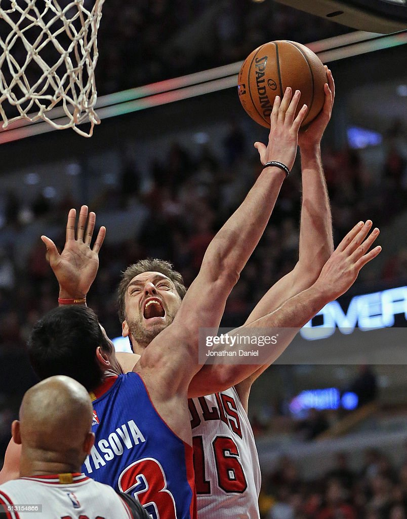 Pau Gasol #16 of the Chicago Bulls shoots over Ersan Ilyasova #23 of the Detroit Pistons at the United Center on December 18, 2015 in Chicago, Illinois. The Pistons defeated the Bulls 147-144 in quadruple overtime.