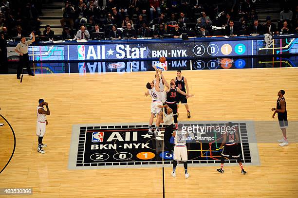 Pau Gasol of the Eastern Conference AllStars battles Marc Gasol of the Western Conference AllStars for the jump ball during the 2015 NBA AllStar Game...