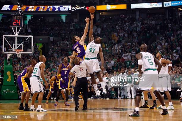 Pau Gasol of the Los Angeles Lakers and Kendrick Perkins of the Boston Celtics go up for the opening tipoff in Game Two of the 2008 NBA Finals on...
