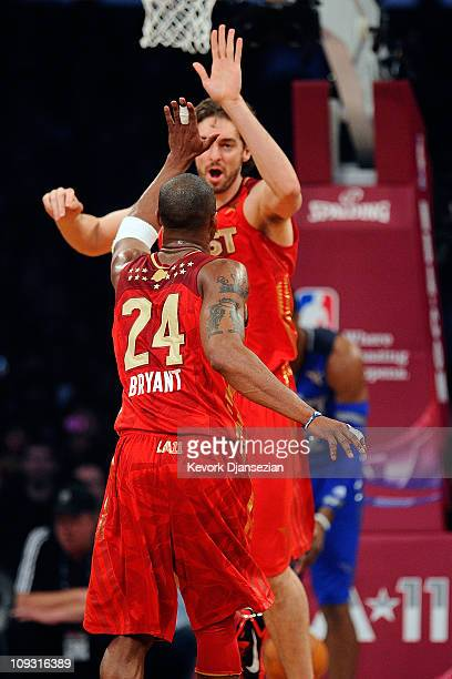 Pau Gasol of the Los Angeles Lakers and the Western Conference and Kobe Bryant of the Los Angeles Lakers and the Western Conference celebrate in the...