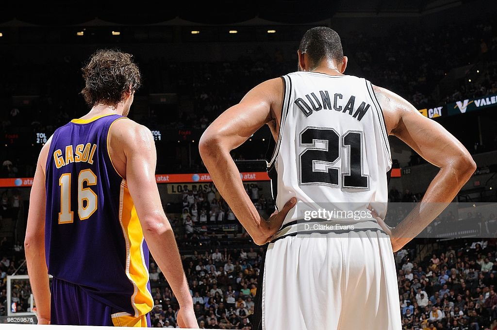 Pau Gasol #16 of the Los Angeles Lakers and Tim Duncan #21 of the San Antonio Spurs stand on the court during the game on March 24, 2010 at the AT&T Center in San Antonio, Texas. The Lakers won 92-83.