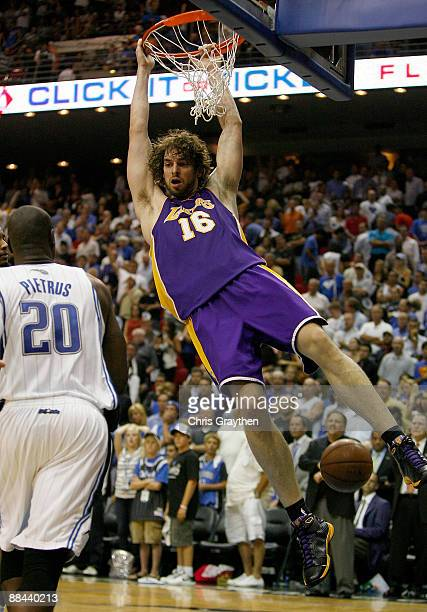 Pau Gasol of the Los Angeles Lakers breaks away for a slam dunk over Mickael Pietrus of the Orlando Magic in the final moments of the Lakers'...