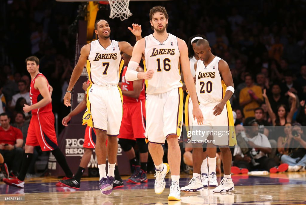 Pau Gasol #16 of the Los Angeles Lakers celebrates along with Xavier Henry # after Gasol made two foul shots to put the Lakers ahead by two points with six seconds remaning against the Atlanta Hawks at Staples Center on November 3, 2013 in Los Angeles, California. The Lakers won 105-103.
