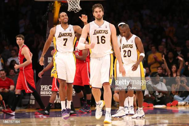 Pau Gasol of the Los Angeles Lakers celebrates along with Xavier Henry # after Gasol made two foul shots to put the Lakers ahead by two points with...