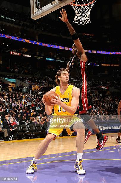 Pau Gasol of the Los Angeles Lakers comes under pressure from Jermaine O'Neal of the Miami Heat during the game on December 4 2009 at Staples Center...