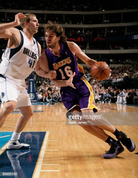 Pau Gasol of the Los Angeles Lakers drives against Dirk Nowitzki of the Dallas Mavericks on November 11 2008 at the American Airlines Center in...