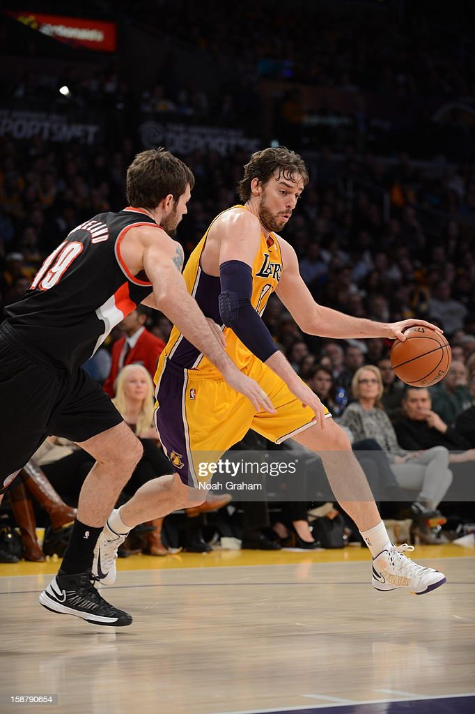 Pau Gasol #16 of the Los Angeles Lakers drives against Joel Freeland #19 of the Portland Trail Blazers at Staples Center on December 28, 2012 in Los Angeles, California.