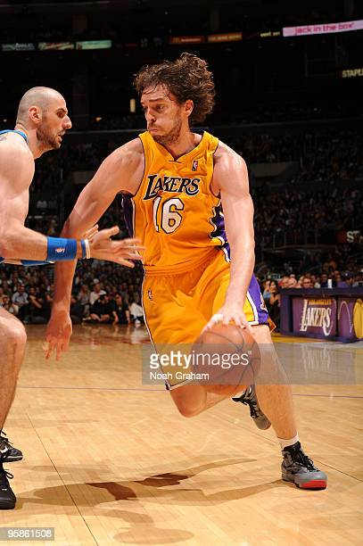 Pau Gasol of the Los Angeles Lakers drives against Marcin Gortat of the Orlando Magic at Staples Center on January 18 2010 in Los Angeles California...