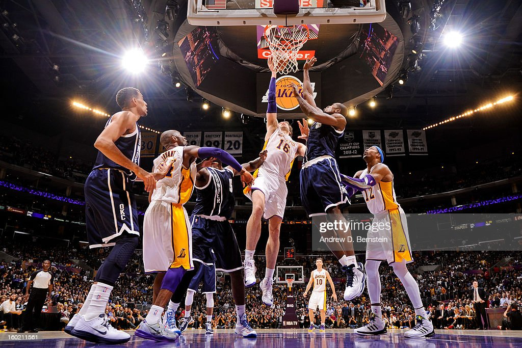 Pau Gasol #16 of the Los Angeles Lakers drives to the basket against Serge Ibaka #9 of the Oklahoma City Thunder at Staples Center on January 27, 2013 in Los Angeles, California.